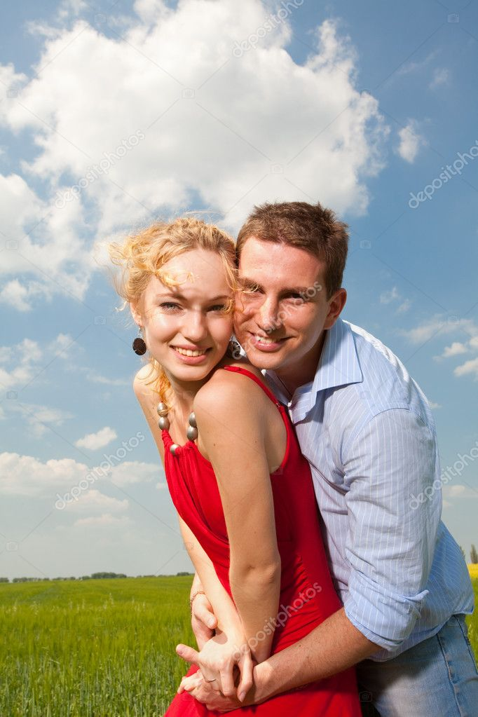 Young love Couple smiling under blue sky  Stock Photo #4710644