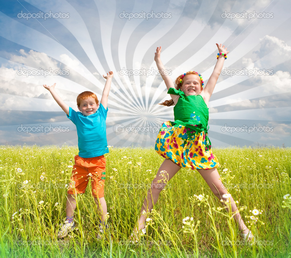 Two golden haired children playin the field stock image