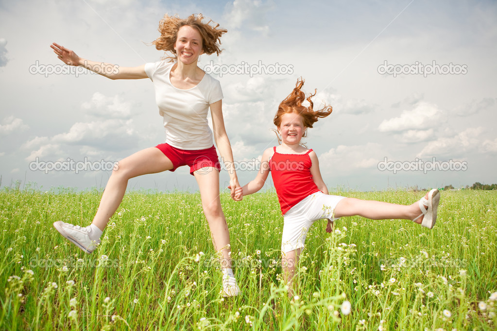 Mom and Daughter Having Fun in the field. Foces on eyes.  Stock Photo #4711075
