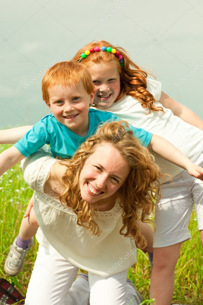 Mother with children goes on field  Foto Stock #4711182