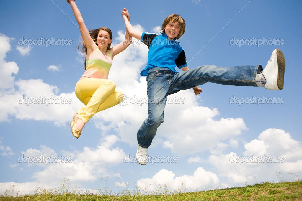 Girl and boy jumping. Soft focus. Focus on eyes — Stock Photo #4711589