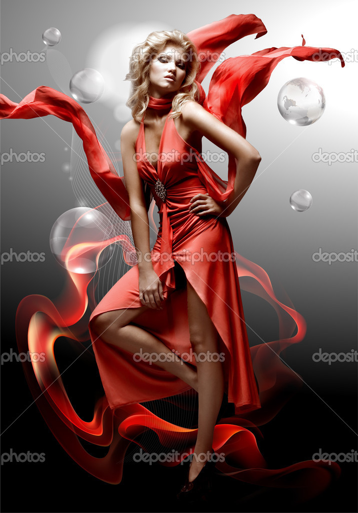 Luxury beautiful young fantasy woman in red dress — Stockfoto #4711853