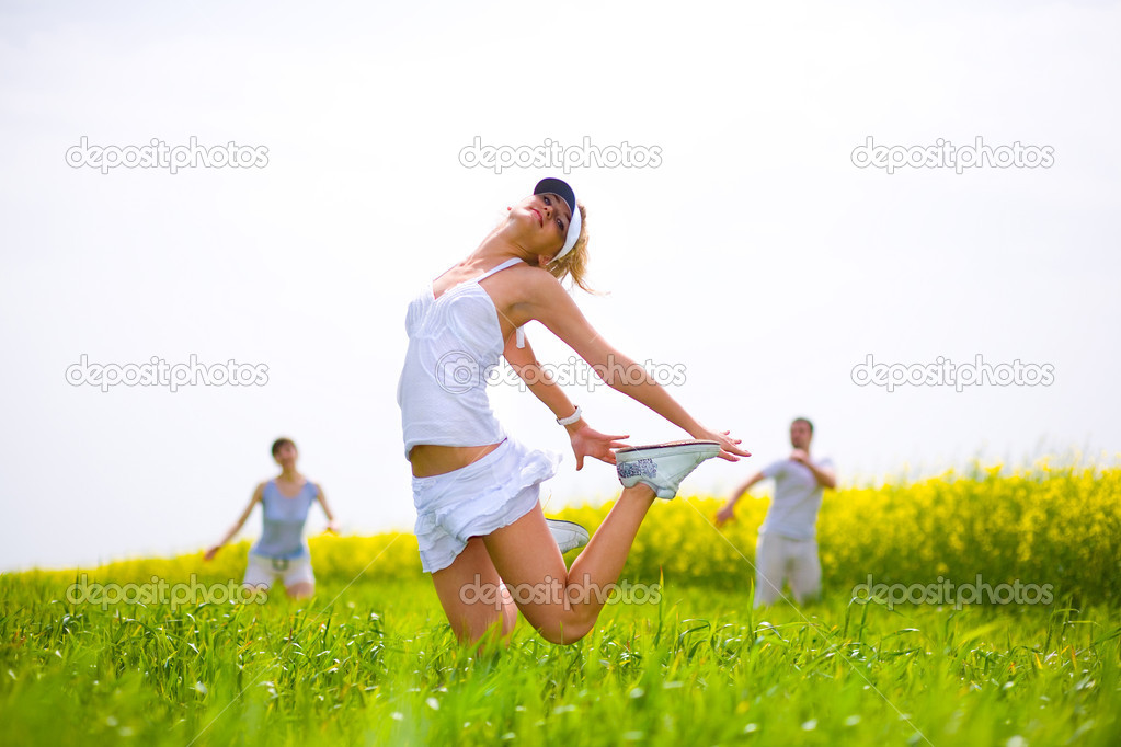 Happy is jumping in a field — Stock Photo #4711904