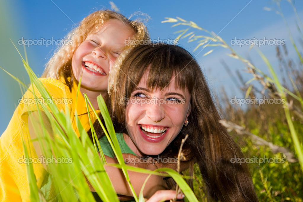 Happy mother and daughter on garden  Stock Photo #4713359
