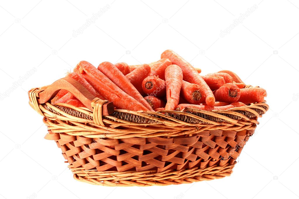 Carrot crop in a deep wattled basket on a white background. — Stock Photo #2705200