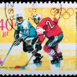 Poland - CIRCA 1968: A stamp Grenoble - Hockey - Stock Photo