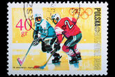Poland - CIRCA 1968: A stamp Grenoble - Hockey — Stock Photo