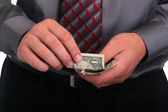 Businessman and money — Stock Photo