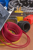 Red wire next to equipment for switch installation. — Stock Photo