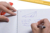 Mathematician doing a mathematic problem in a notebook. — Stock Photo
