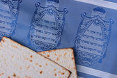 Two pieces of matzah laying on a blue tallit representing Jewish symbols. — Stock Photo