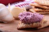 Wheat crackers with cream. — Stock Photo