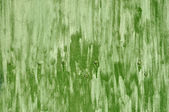 Rough green colored surface with bolts — Stock Photo