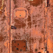 Stock Photo: Rusty red metal gate background