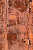 Rusty red metal gate background — Stock Photo