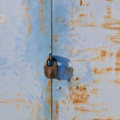 Rusty blue metal gate with padlock — Stock Photo