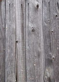 Weathered gray wooden boards background — Photo