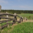 Old pole fence on outskirts — Stock Photo