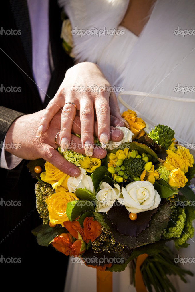 Wedding bouquet in bride's and groom's hands  Stock Photo #3025276