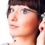Closeup of a woman applying mascara — Stock Photo