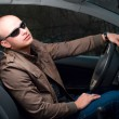Driver in sunglasses — Stock Photo