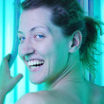 Beautiful woman in solarium — Stock Photo