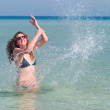 Funny woman splasing in the sea — Stock Photo #3203658