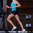 Beautiful woman is running on the treadmill — Stock Photo #3203875