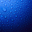 Blue water drops on glass — Stock Photo