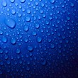 Blue water drops on glass — Stock Photo #3203914