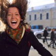 Laughing woman on spring city street — Stock Photo