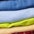 Stack of multicolored men's clothing — Stock Photo
