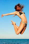 Jump over sea — Stock Photo