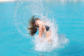 Jumping out of pool — Stock Photo