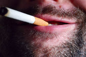 Unshaven smoker — Stockfoto