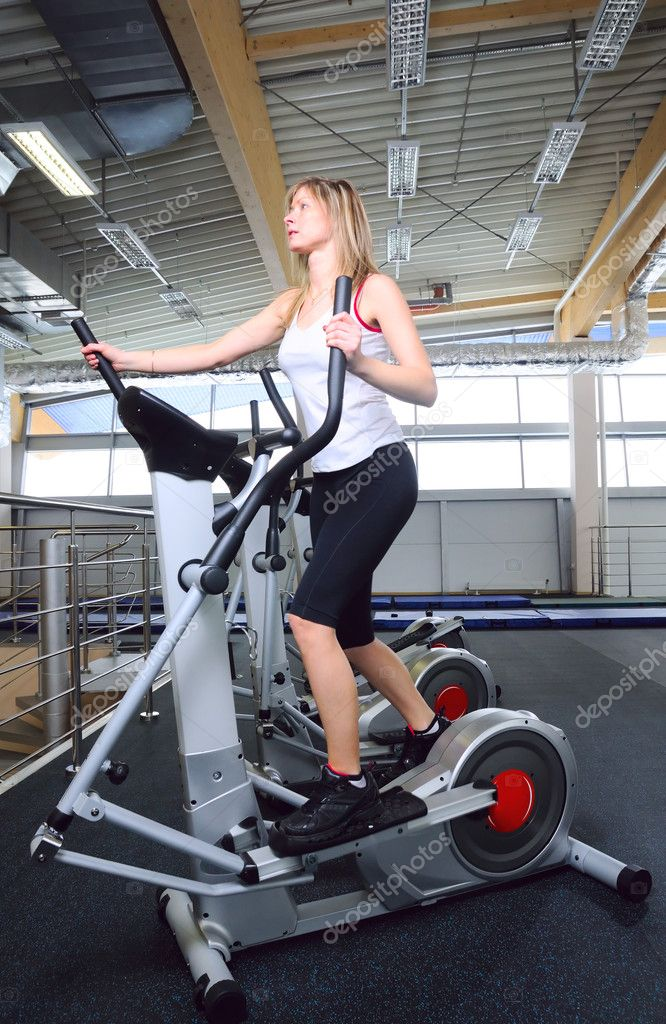 Woman on cardio machine  Stock Photo #3203399