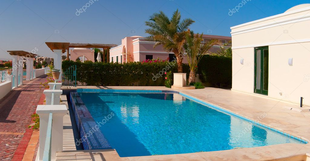 Swimming pool near the house stock photo for Swimming pool close to house
