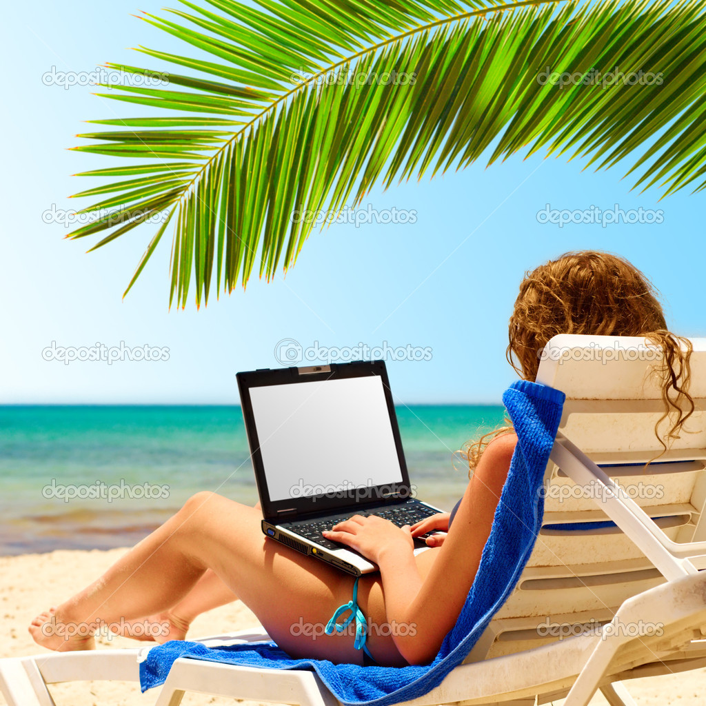 surfing on the beach. Laptop display is cut with clipping path — Stock Photo #3203879