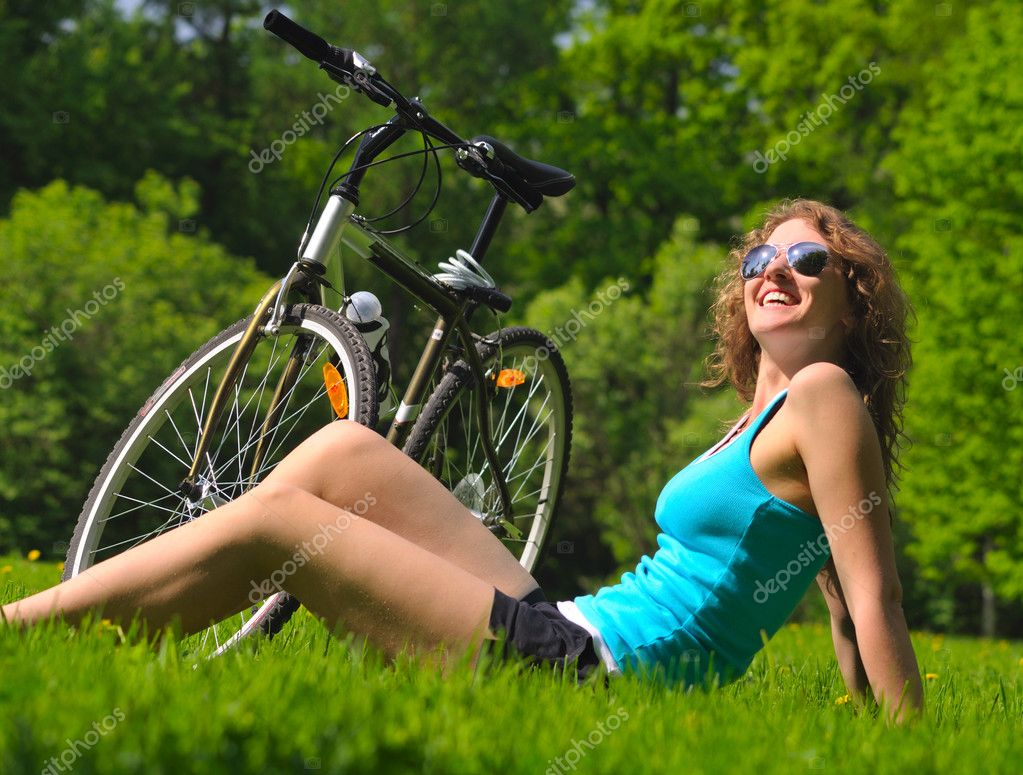 Sitting woman and bike - Stock Image: depositphotos.com/3204321/stock-photo-sitting-woman-and-bike.html