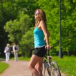 Woman with bicycle in park — Stock Photo #3273510