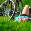 Woman is lying near her bicycle — Stock Photo