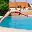 Woman jumping into the pool — Stock Photo #3358679