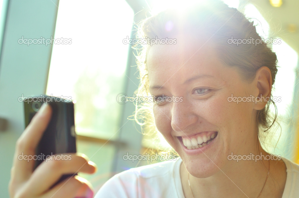 Woman is watching at phone — Stock Photo #3440044