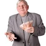 Elderly man with money in hands — Stock Photo