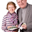 Stock Photo: Elderly married couple with money