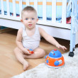 Baby playing at home - Stock Photo