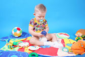 Child playing toys — Stock Photo