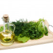 Fresh green-stuffs on cutting board - Stock Photo