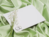 Rings, card and lily of the valley — Stock Photo