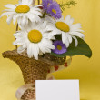 Stock Photo: Card for text and camomile in a small basket